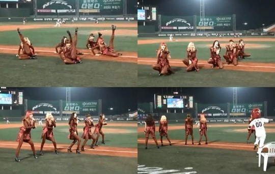 RaNia in red see-through outfits performs at a baseball game